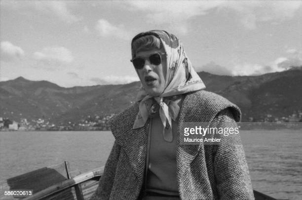 Transsexual Roberta Cowell , formerly Robert Cowell, on board a boat, March 1954. Roberta was once a Spitfire pilot, prisoner of war, racing...