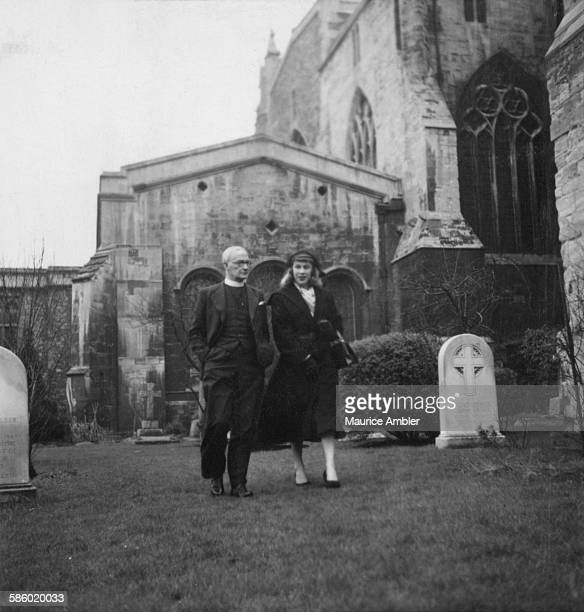 Transsexual Roberta Cowell , formerly Robert Cowell with friend and advisor Canon Arthur Russell Millbourn of Bristol Cathedral, March 1954. Roberta...