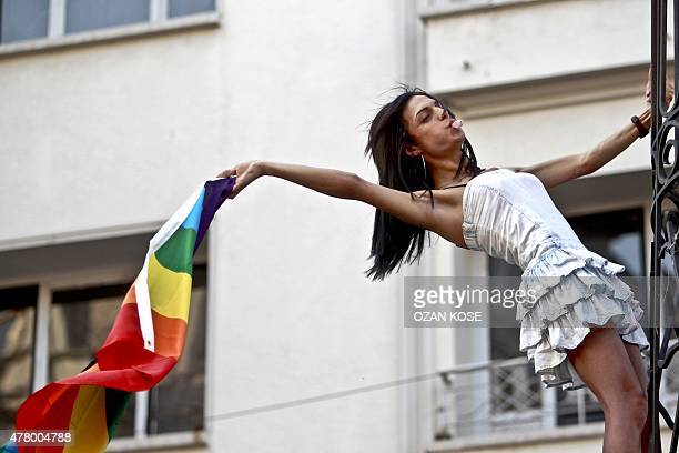 A transsexual waves a gay rainbow flag during the annual Transgender Pride march along Istikbal Avenue in Istanbul on June 21 2015 AFP PHOTO / OZAN...
