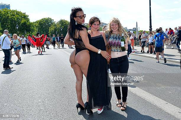 Transsexuals poses as thousands of people gather to support gay rights by celebrating during the Gay Pride Parade on June 27 2015 in Paris France...