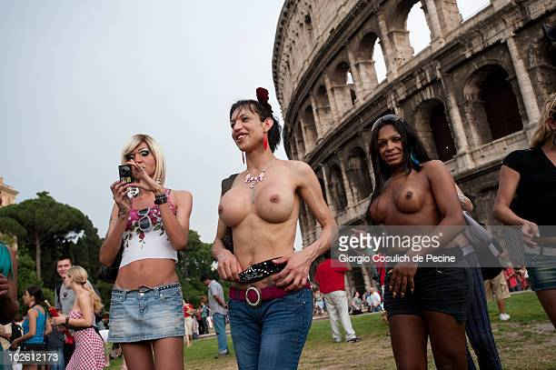 Transsexuals stand in front of the Coliseum during the annual Gay Pride parade on July 3 2010 in Rome Italy Thousands of activists and supporters of...