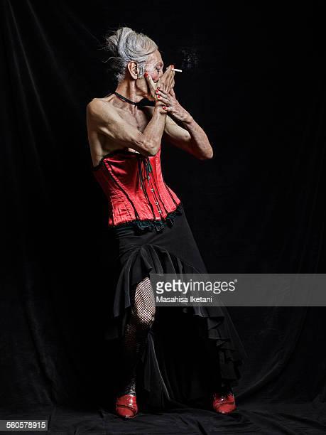 transvestite Asian senior man dancing