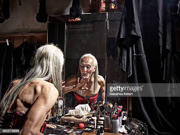 transvestite Asian Senior man making up