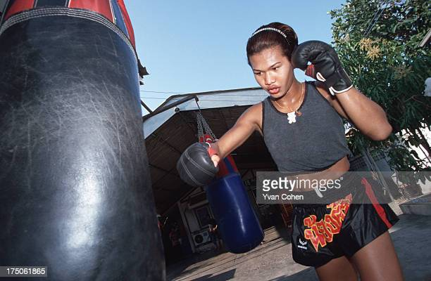 Transvestite boxer Parinya Kiatbusaba in training at the Paiyanan boxing camp in Cholburi province Parinya has since had a sexchange operation and is...