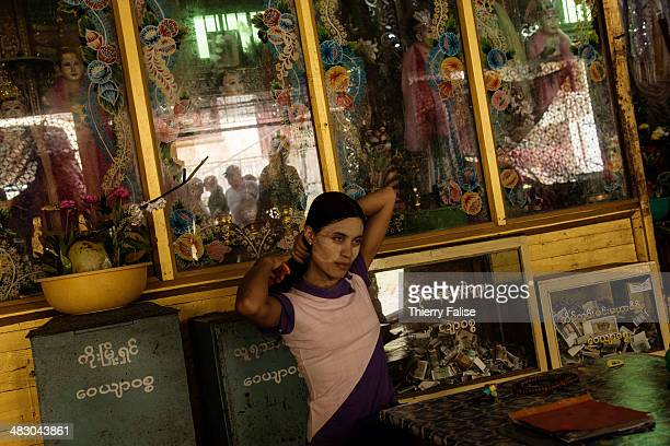 A transvestite considered as a intermediary between the nats and the human beings sits in a temple at the foot of Mount Popa a volcano standing 1520...