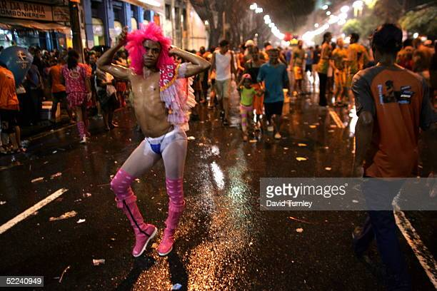 A transvestite dances through the streets during Carnival on February 8 2005 in Salvador Brazil Centuries of slave trade with Central and West Africa...