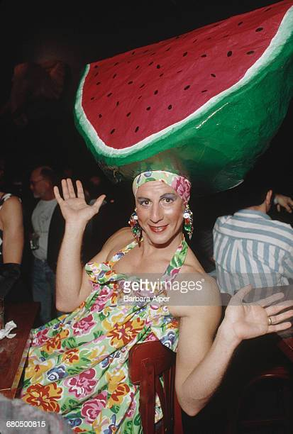 A transvestite man wearing a large model watermelon on his head during the Castro Street Fair an LGBT street festival in San Francisco October 1992