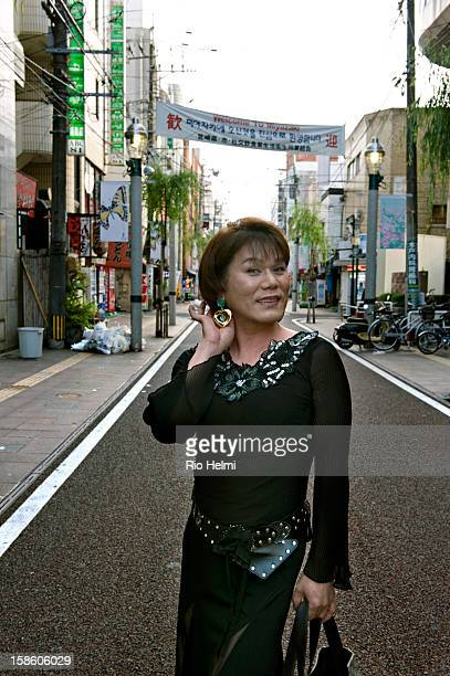 A transvestite on the way home early in the morning after working all night at a bar in Miyazaki's night entertainment district