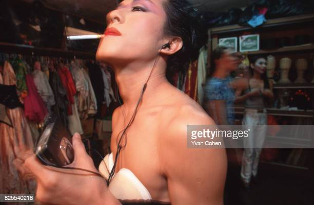 A transvestite performer rehearses backstage before a cabaret show at a nightclub in Soi 4 off Silom Road in downtown Bangkok Transexuals called...