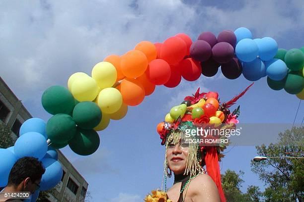 A transvestite poses 29 June 2002 in San Salvador El Salvador during the gay pride parade AFP PHOTO/Edgar ROMERO Un travesti se exhibe el 29 de junio...