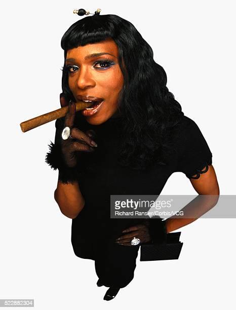 transvestite smoking a cigar - black transvestite stock pictures, royalty-free photos & images