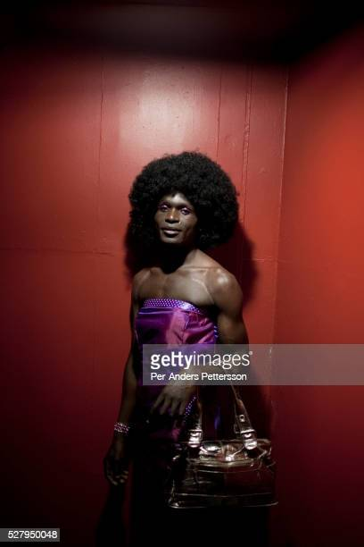 A transvestite waits backstage before a Miss Mr Gay pageant in Athlone outside Cape town South Africa