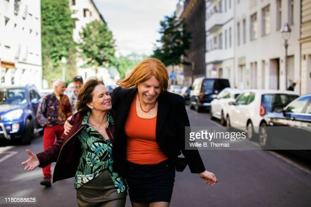 transvestite walking with wife - lgbtq  female stock pictures, royalty-free photos & images