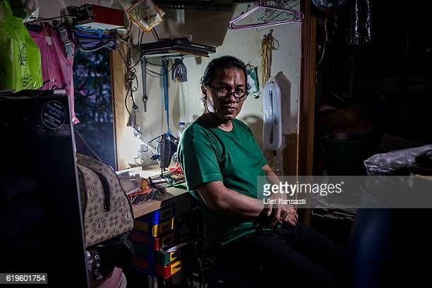A transvestite Yanti poses for photograph inside her house Yanti has joined the group for 22 years in a traditional dance opera group called Ludruk...