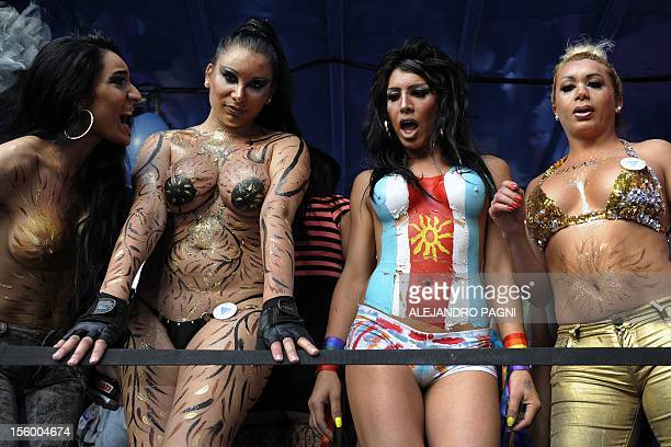 Transvestites and transsexuals participate of the XXI Gay Pride Parade at Mayo square in Buenos Aires on November 10 2012 AFP PHOTO / Alejandro PAGNI