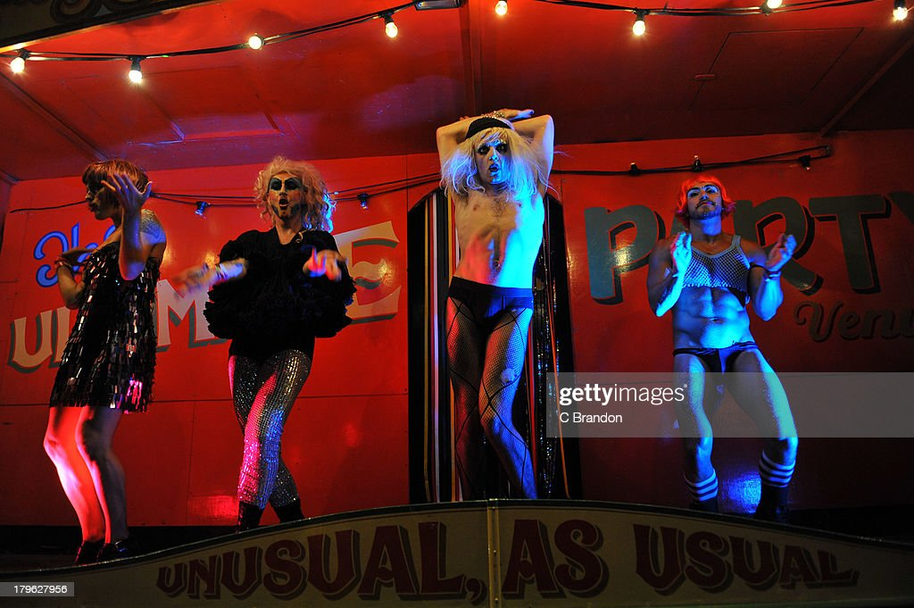 Transvestites perform on stage during on Day 1 of Bestival 2013 at Robin Hill Country Park on September 5, 2013 in Newport, Isle of Wight.