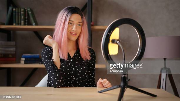 transwoman shoots video for blog with phone and ring light - lighting equipment stock pictures, royalty-free photos & images