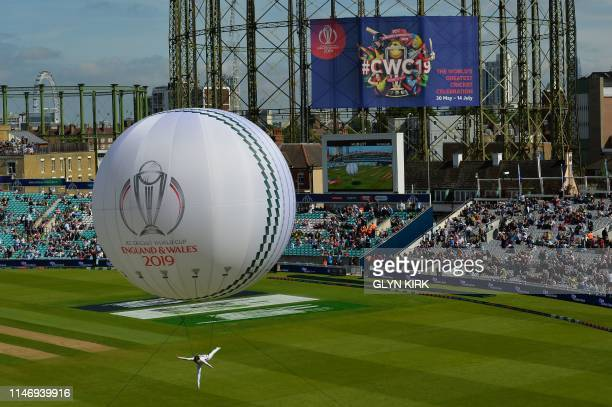 A trapeze artist performs from a balloon during an opening ceremony before the start of the 2019 Cricket World Cup group stage match between England...