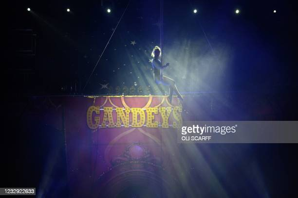 Trapeze artist with Gandeys Circus, Europe's largest touring big top show, founded over 90 years ago, rehearses in the circus big top prior to...