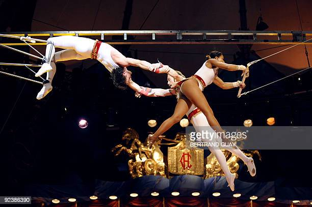 FRENCH Trapeze artists from the 'Flying Star' perform during a rehearsal of the circus show 'Festif' at the Cirque d'Hiver Bouglione on October 23...