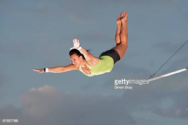 trapeze is a popular new exercise in the states - trapeze artist stock photos and pictures
