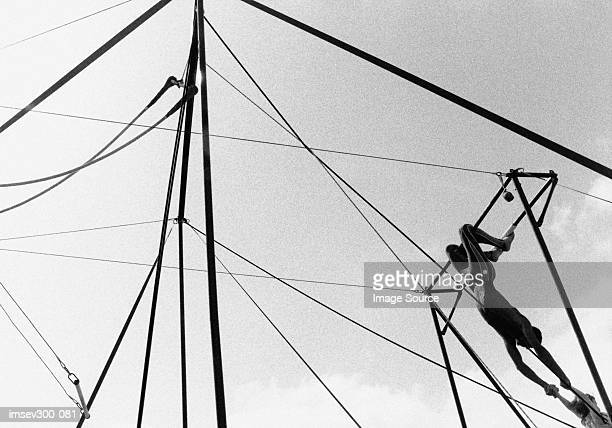 trapeze - trapeze artist stock photos and pictures