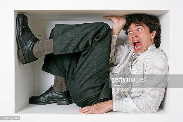trapped businessman - confined space stock pictures, royalty-free photos & images