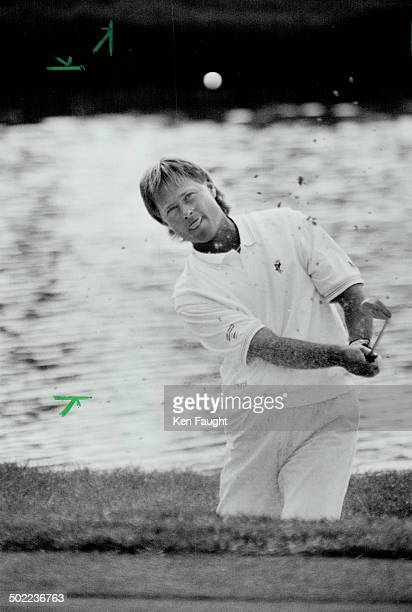 Trapped John Cook Open champ in '83 and one of 10 participants in yesterday's du Maurier Shoot Out blasts out of bunker but is not pleased with how...