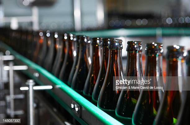 trappist beer factory, bottle chain - belgium stock pictures, royalty-free photos & images