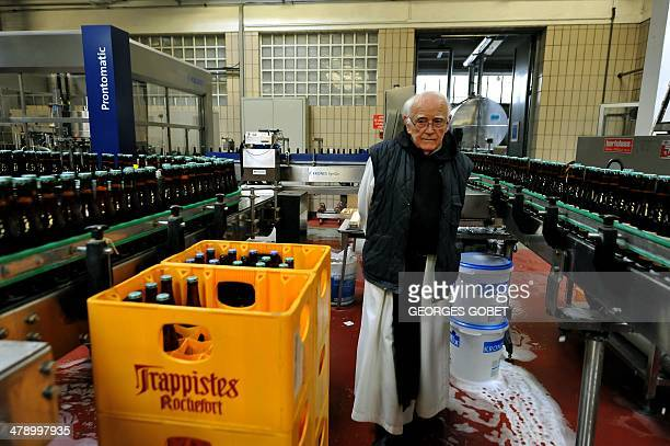 A trappist monk oversees the bottling of Trappistes Rochefort beer on February 19 2014 at the Notre Dame de Saint Remy Rochefort abbey in Rochefort...