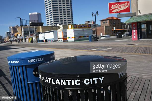 Trash and recycling bins stand on a nearly empty boardwalk March 30 2016 in Atlantic City New Jersey Atlantic City is due to run out of funds facing...
