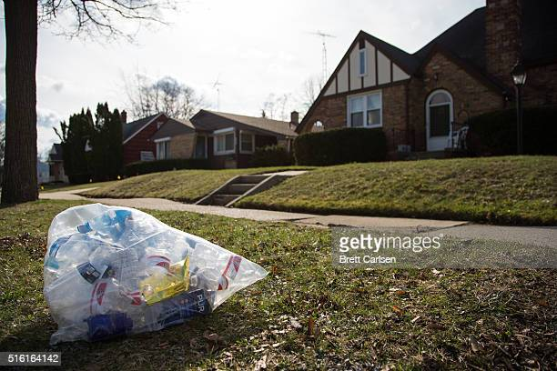 A trash bag filled with empty water bottles and water filters outside of a house on March 17 2016 in Flint Michigan Flint continues to work through...