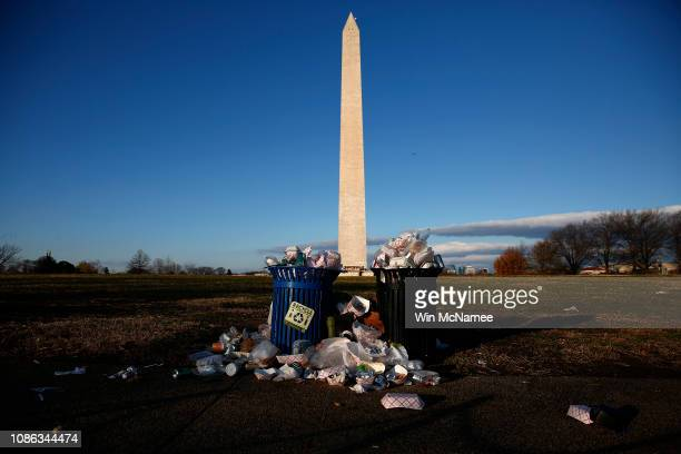 Trash begins to accumulate along the National Mall near the Washington Monument due to a partial shutdown of the federal government on December 24,...