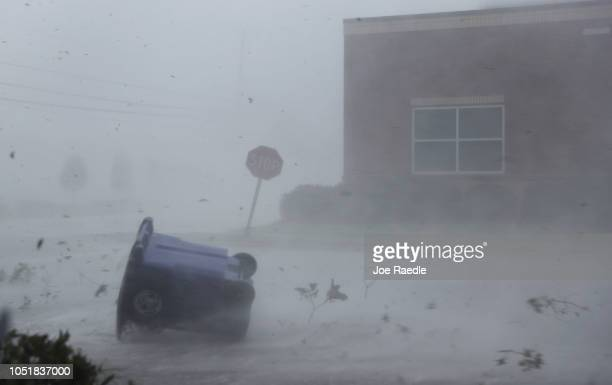 A trash can and debris are blown down a street by Hurricane Michael on October 10 2018 in Panama City Florida The hurricane made landfall on the...