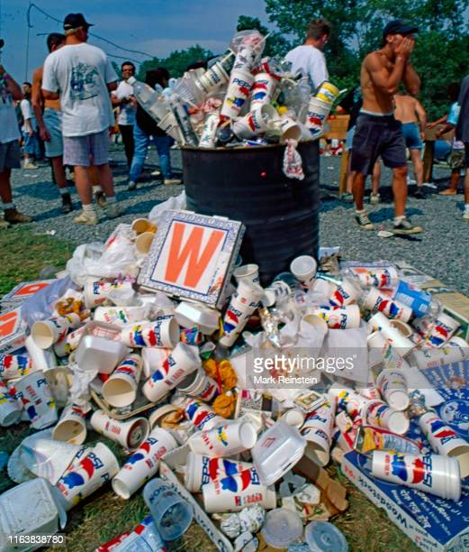 Trash can overflows with debris and litter at the Woodstock 94 festival in Saugerties, New York, August 13, 1994.