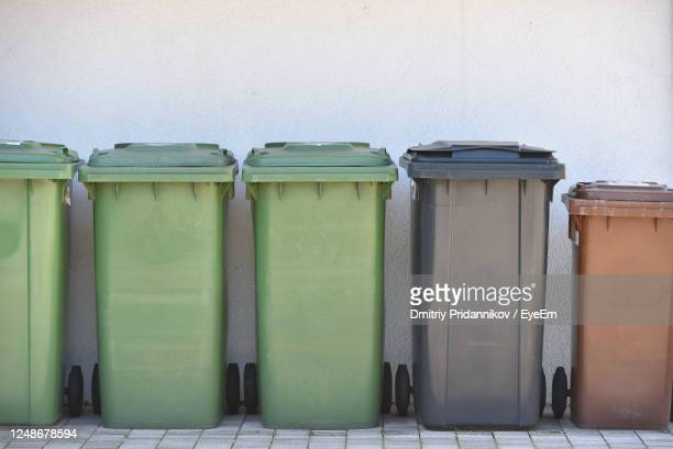 trash cans against the wall - rubbish bin stock pictures, royalty-free photos & images