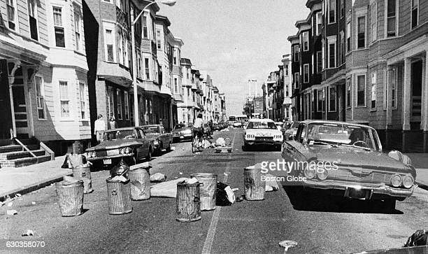 Trash cans and litter cover L Street in South Boston after a protest Sept 16 1974 An initiative to desegregate Boston Public Schools was implemented...