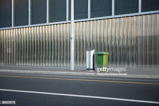 Trash cans on sidewalk