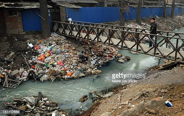 Trash clogs up a polluted canal at the edge of Beijing on March 16 2012 China said that twothirds of its cities currently fail to meet new airquality...