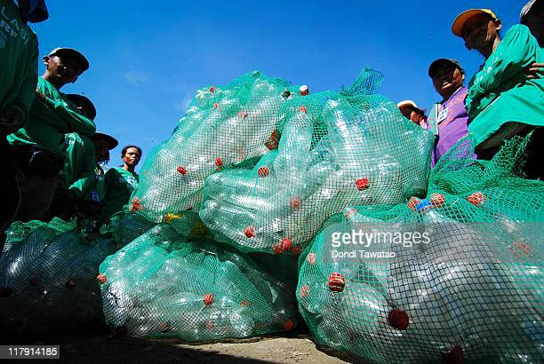 Trash collectors at the dumpsite known as 'Bulasi' or waste pickers collect plastic bottles to be washed on July 2 2011 in Quezon City Philippines...