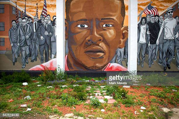 Trash collects below a mural of Freddie Gray after Baltimore police officer Caesar Goodson Jr was found not guilty on all charges on June 23 2016 in...