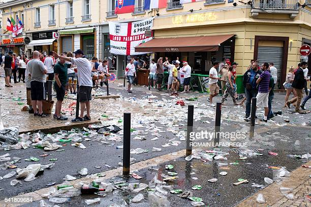 Trash covers JeanJaures square in SaintEtienne on June 20 before the Euro 2016 group B football match between Slovakia and England / AFP / ROMAIN...