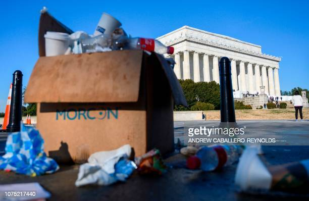 Trash in a box overflows near the Lincoln memorial as some government services have been stopped during a government shutdown in Washington DC...