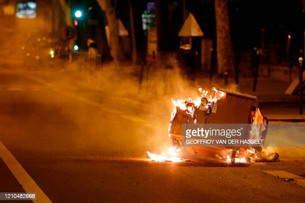 A trash in burns in the street during clashes in VilleneuvelaGarenne in the northern suburbs of Paris early on April 21 2020 Tension with the police...