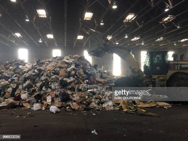 Trash is piled up at the District of Columbias Fort Totten Transfer Station in Washington DC on July 10 2018 Since China the top global importer of...