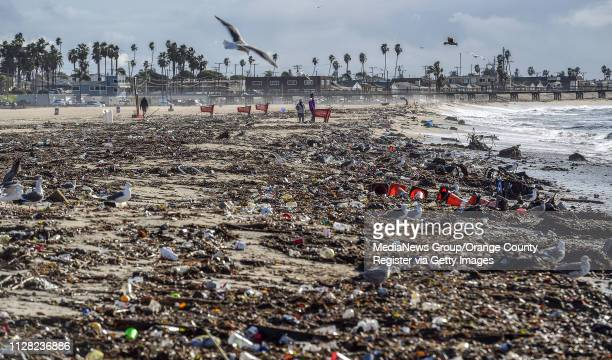 Trash is strewn along the sand south of the San Gabriel River in Seal Beach CA on Monday Feb 4 2019