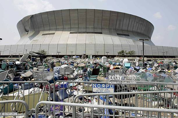 Trash is strewn outside the fully evacuated Superdome 05 September 2005 in New Orleans LA The complete evacuation of New Orleans was necessary...