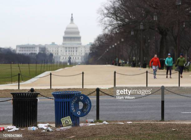 Trash lays on the grounds of the National Mall as the partial shutdown of the US government goes into the 12th day on January 2 2019 in Washington DC...