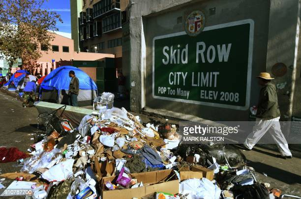 Trash lies beside the Skid Row City Limit mural as the city begins its annual homeless count in Los Angeles California on January 26 2018 Thousnads...