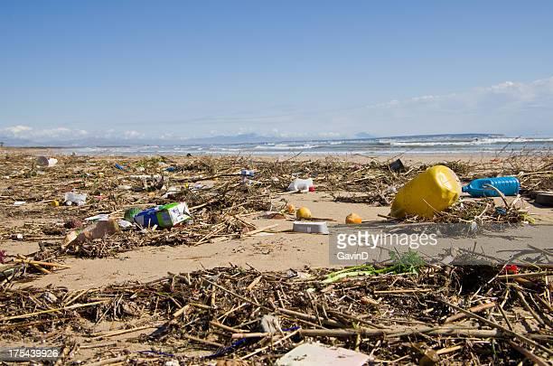 Trash on beach full of rubbish